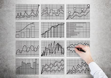 Man hand drawing business charts Royalty Free Stock Photos