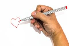 Man hand is drawing heart sign with red marker pen Stock Photos