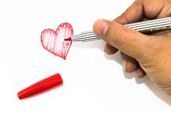 Man hand is drawing heart sign with red marker pen Royalty Free Stock Image