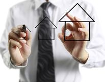 Hand drawing  house. Man hand drawing a house Royalty Free Stock Photography