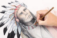 Man hand drawing picture with chieftain. Man hand drawing pencil picture with american indian chieftain stock photography