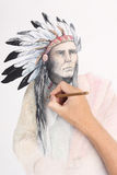 Man hand drawingpicture with american indian Stock Photos