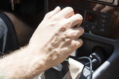 Man hand drivin in a car Royalty Free Stock Photos