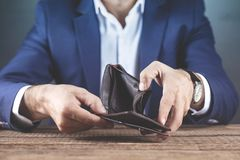 Man hand empty wallet. Young man hand empty wallet on table stock image