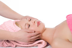 Man hand facial massage to blonde girl. On white background royalty free stock photos