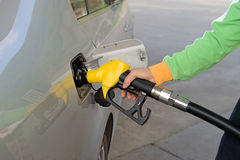 Man hand fill up fuel at gas station Stock Image
