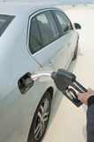 Man hand fill up fuel at gas station Stock Photo