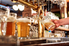 Man hand filling glass of alcohol beverage Royalty Free Stock Photos