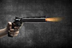 Man Hand Firing Gun. Man hand holding gun and firing it Stock Image