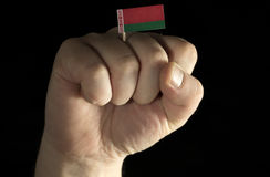 Man hand fist with Belarusian flag isolated on black Royalty Free Stock Photography