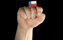 Man hand fist with Chilean flag isolated on black Royalty Free Stock Image