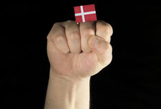 Man hand fist with Danish flag isolated on black Royalty Free Stock Photography