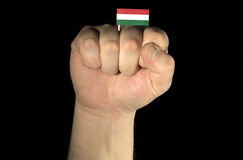 Man hand fist with Hungarian flag isolated on black background Stock Photo