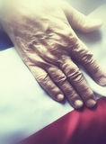 Man with hand on flag of France Stock Images