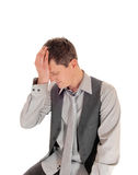 Man with hand on forehead. Royalty Free Stock Photos