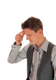 Man with hand on forehead. Stock Photo