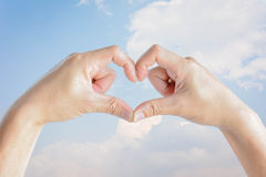 Man hand forming a heart Stock Photo