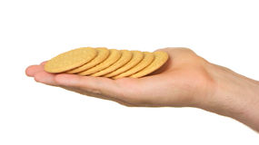 Man with a hand full of biscuits Royalty Free Stock Photography