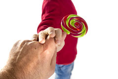Man hand give candy to child Stock Photo