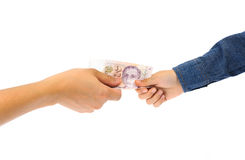 Man hand giving bank note to kid hand stock photography