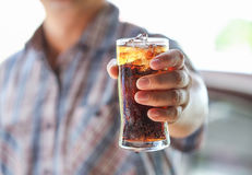 Man Hand Giving Glass Of Sparkling Water. Royalty Free Stock Photography