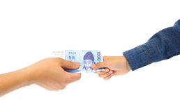 Man hand giving korean won bank note to kid hand royalty free stock image