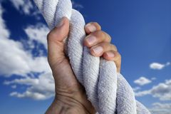 Man hand grab grip strong climb to sky big rope Royalty Free Stock Images