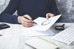 Man hand graph on desk royalty free stock photo