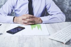 Man hand on graph royalty free stock photo