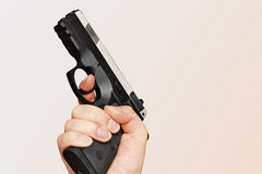 Man with hand gun pistol rubber attack violence photomanipulation. Real hand gun pistole 9mm for your design stock photos