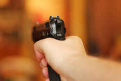 Man with hand gun pistol rubber attack violence photomanipulation. Real hand gun pistole 9mm for your design stock image