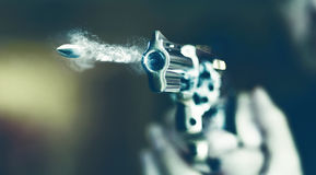 Man with hand gun pistol rubber attack violence photomanipulation. Real hand gun pistole 9mm for your design royalty free stock photo