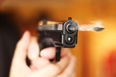 Man with hand gun pistol rubber attack violence photomanipulation. Real hand gun pistole 9mm for your design stock images