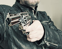 Man with hand gun pistol rubber attack violence photomanipulation. Real hand gun pistole 9mm for your design royalty free stock images