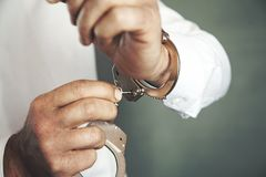 Man hand handcuffs and key stock photos