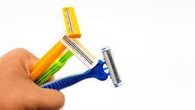 Man hand hold razor two and three knives in variety color and de. Man hand hold the razor two and three knives in variety color and design isolated Stock Images