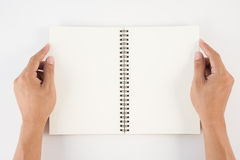Man hand holding blank book  on white background for text and ba Stock Photos