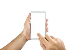 Man hand holding blank mobile smart phone isolated on white back. Hand holding blank mobile smart phone isolated on white background with clipping path Stock Photos