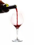 Man Hand holding Bottle filling Glass with Red Wine Stock Photos