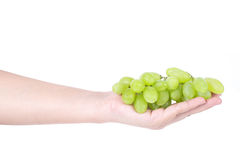 Man hand holding a bunch of green grapes, Isolated on white background Royalty Free Stock Image