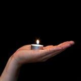 Man hand holding burning candle Royalty Free Stock Photos