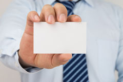 Man hand holding a business card Royalty Free Stock Images