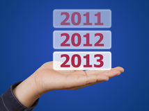 Man hand holding button 2013 keyword Stock Photos