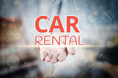 Man hand holding Car Rental text on blurry home icon property ba Stock Photography