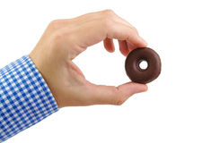 Man hand holding a chocolate donut cookie isolated Royalty Free Stock Photo