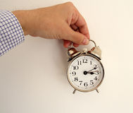 Man hand holding clock Royalty Free Stock Images