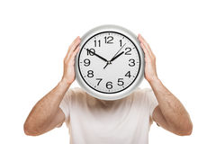 Man hand holding clock isolated Stock Images
