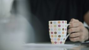 Man hand holding coffee cup. Close up of male hand preparing to drink tea. Closeup of male hand holding tea cup. Male student drink coffee at morning stock video