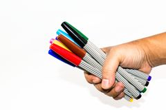 Man hand holding the colorful marker pen Royalty Free Stock Photos