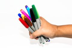 Man hand holding the colorful marker pen Stock Photography